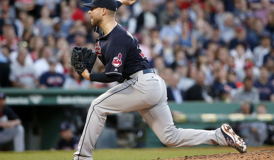 Cleveland Indians' Corey Kluber pitches during the first inning of a baseball game against the Boston Red Sox in Boston, Friday, May 20, 2016. (AP Photo/Michael Dwyer)