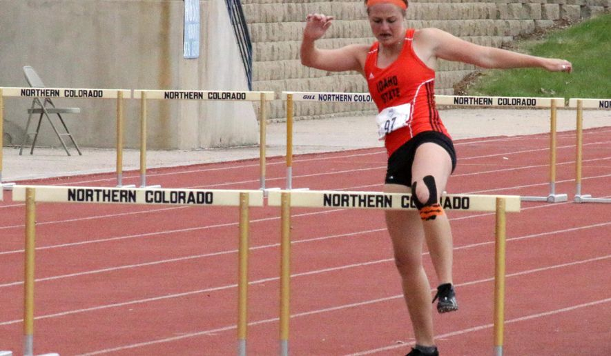 In this photo taken Saturday, May 14, 2016, and provided by Northern Arizona University, Idaho State's Shelby Erdahl struggles to finishes the 400-meter hurdle race after she ruptured her Achilles tendon on the second hurdle at the Big Sky Conference Outdoor Track and Field Championships in Greeley, Colo. Erdahl ignored the pain shooting up her leg, hobbled over eight more hurdles with a numb foot and crossed the finish line to meet her goal of scoring a point for her team. (Brian Campbell/Northern Arizona University via AP)