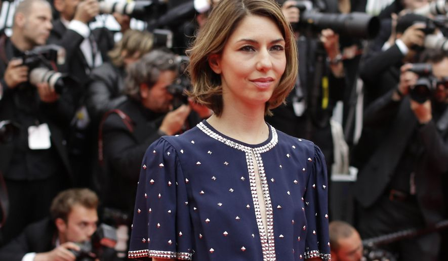 "FILE - In this Monday, May 19, 2014 file photo, Sofia Coppola poses for photographers as she arrives for the screening of Foxcatcher at the 67th international film festival, Cannes, southern France. Oscar-winning film director Sofia Coppola is taking a break from movies to direct a new production of Verdi's ""La Traviata"" at the Rome Opera House. She told reporters Friday, May 20, 2016 that Valentino's invitation to work in opera was ""scary"" and ""very unfamiliar"" for her, but that she was motivated by the opportunity to work in the Rome Opera House ""with the very beautiful costumes.""(AP Photo/Thibault Camus, file)"