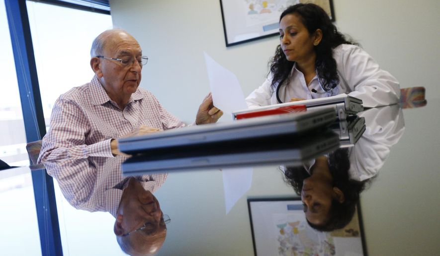 ADVANCE FOR USE MONDAY, MAY 23, 2016 AND THEREAFTER - In this Wednesday, April 13, 2016 photo, Herbert Diamond, 88, left, of Fort Lee, N.J., speaks with Dr. Manisha Parulekar about his end of life preferences, at the Hackensack Medical Center in Hackensack, N.J. Such conversations, are slowly spreading across the U.S. as Medicare rolls out government payments for the consultations. (AP Photo/Julio Cortez)