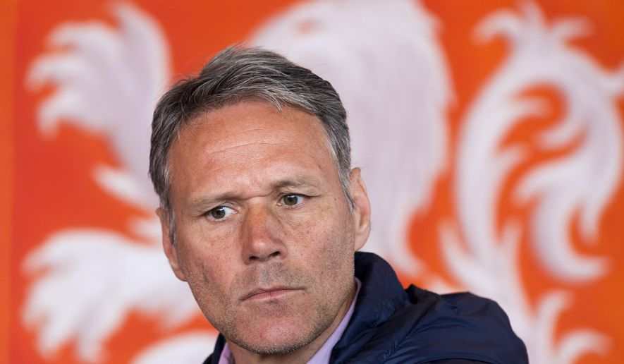 Dutch former soccer star Marco van Basten is seated in front of the logo of the Dutch soccer association KNVB during a presentation of  video referee assistance in Amsterdam, Netherlands, Friday, May 20, 2016. (AP Photo/Peter Dejong)