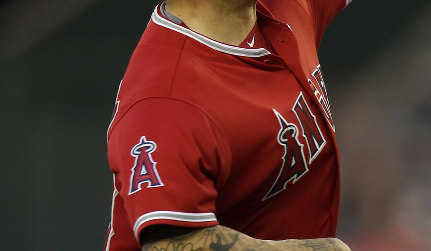 Los Angeles Angels starting pitcher Hector Santiago pitches to Baltimore Orioles' Joey Rickard during the first inning of a baseball game in Anaheim, Calif., Friday, May 20, 2016. (AP Photo/Kelvin Kuo)