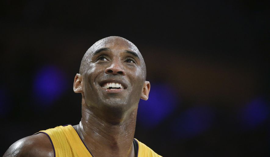 "FILE - In this April 13, 2016 file photo, Los Angeles Lakers forward Kobe Bryant smiles during the first half of Bryant's last NBA basketball game, against the Utah Jazz in Los Angeles. Bryant is getting advice from Steven Spielberg, J.J. Abrams and Jerry Bruckheimer as he redirects his competitive drive from professional basketball to his publishing and production company. One month after retiring from the NBA, the Los Angeles Lakers star has a new daily routine. ""I get up early and I train and I work out. Then I go to the office,"" Bryant said in an interview Wednesday, May 18, 2016.(AP Photo/Jae C. Hong, File)"