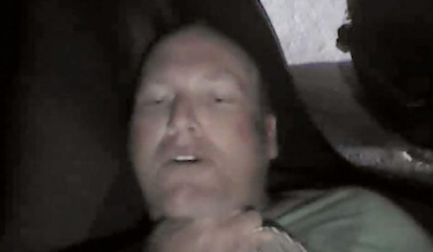 This Nov. 20, 2015, frame grab from video taken from a body camera worn by a Coweta County, Ga., Sheriff's Department deputy shows Chase Sherman, 32, of Destin, Fla., being held down by a deputy in the back seat of a car outside Atlanta. Deputies who responded to a call from Sherman's mother attempted to subdue Sherman by using electronic control devices. Then they realized Sherman has stopped breathing and moved him out of the vehicle. Sherman was pronounced dead at a hospital later that day. ( Coweta Country District Attorney's Office via AP)