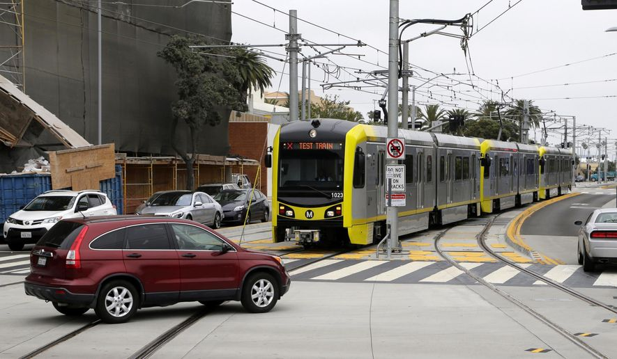 This Wednesday, May 18, 2016 photo shows a train approaching the new Metro Expo Line station in Santa Monica, Calif. For the first time since the 1950s, a Southern California light rail line will extend to the Pacific. Starting Friday, May 20, 2016, with the opening of the 6.6-mile extension of the Expo Line, riders can now take Metro rail from the far-inland suburb of Azusa some 40 miles to the sands of Santa Monica. (AP Photo/Nick Ut)