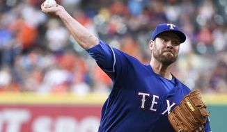Texas Rangers starting pitcher Colby Lewis delivers in the first inning of a baseball game against the Houston Astros, Friday, May 20, 2016, in Houston. (AP Photo/Eric Christian Smith)