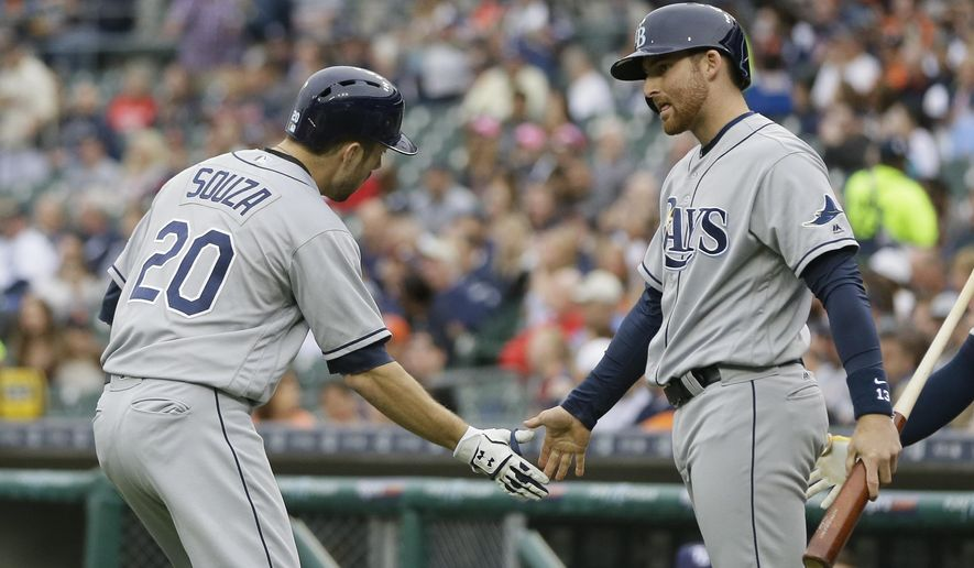 Tampa Bay Rays' Brad Miller, right, congratulates teammate Steven Souza Jr. (20) after Souza's solo home run off Detroit Tigers starting pitcher Anibal Sanchez during the first inning of a baseball game, Friday, May 20, 2016, in Detroit. (AP Photo/Carlos Osorio)