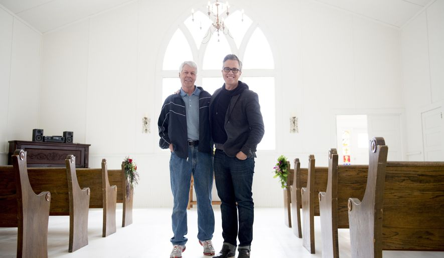 Reed Cowan and his father, Russell Cowan, stand in the chapel of the 100-year-old Myton Community Presbyterian Church in Myton, Utah, on Saturday, April 30, 2016. Reed, who is a news anchor in Las Vegas, purchased the church in December 2015 with plans to renovate it into a second home but has instead decided to make the church available for weddings and other community events. (Jeremy Harmon/The Salt Lake Tribune via AP)