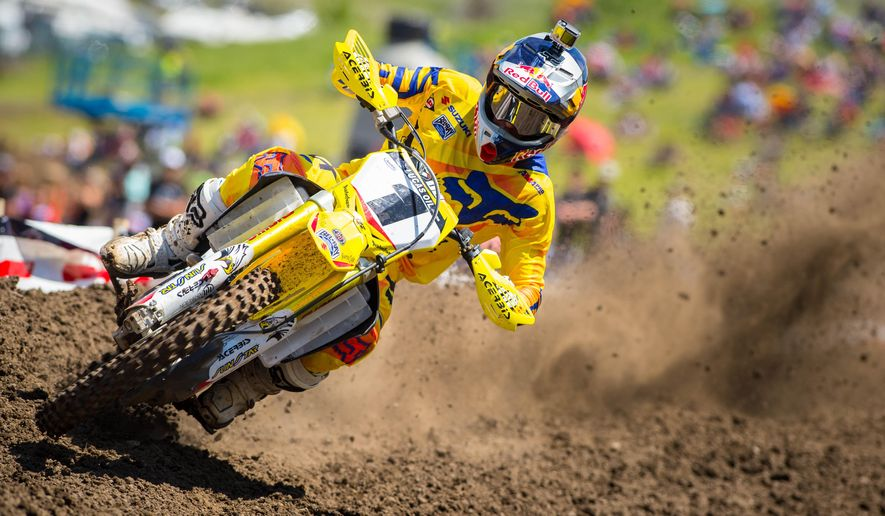 In this photo taken May 30, 2015, and provided by Lucas Oil Pro Motocross Championship, Ken Roczen rides during a 450cc class motocross race at Thunder Valley in Lakewood, Colo. Roczen's family drove their RV home around Europe so he could race dirt bikes. Those early sacrifices have helped turn the German rider into one of the best motocross riders in the world. (Simon Cudby/Lucas Oil Pro Motocross Championship via AP)