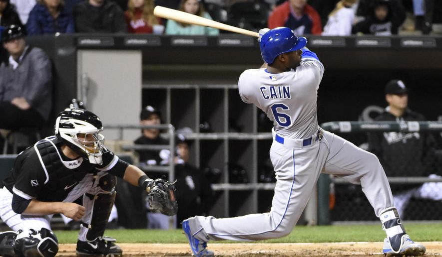 Kansas City Royals' Lorenzo Cain (6) hits an RBI double against the Chicago White Sox during the sixth inning of a baseball game, Friday, May 20, 2016, in Chicago. (AP Photo/David Banks)