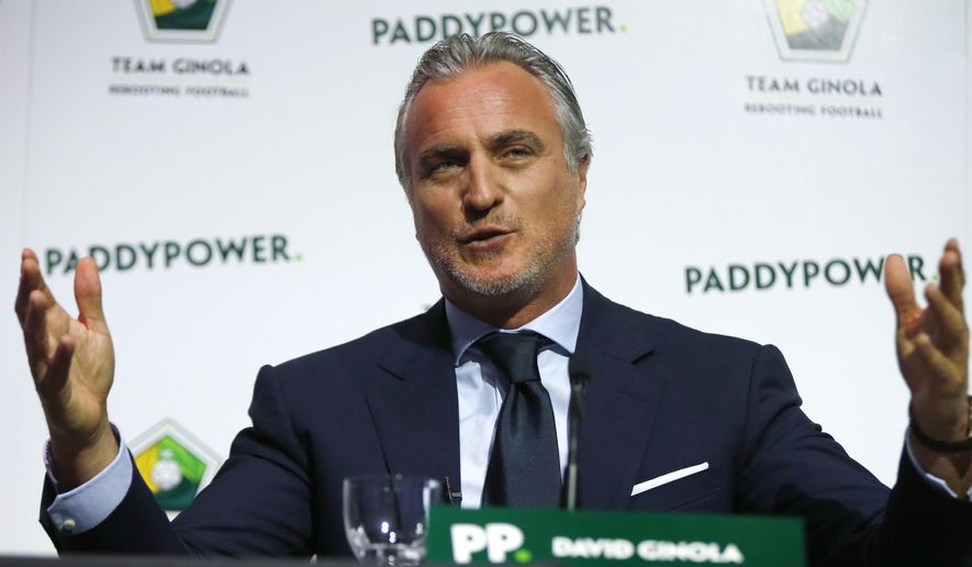 FILE - In this  Friday Jan. 16, 2015 file photo, Former France soccer player David Ginola speaks at a press conference to launch his bid to challenge Sepp Blatter for the FIFA presidency, in London. Former France player David Ginola has reportedly been hospitalized after feeling unwell while playing golf on Thursday, May 19, 2016. According to local newspaper Nice Matin, the 49-year-old David Ginola was airlifted unconscious but in stable condition to the Monaco cardiothoracic center after a heart attack. (AP Photo/Alastair Grant, file)