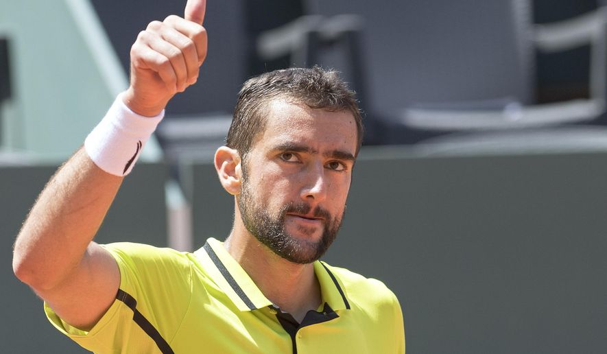 Marin Cilic, of Croatia, reacts after winning a game against David Ferrer of Spain, during the Semifinal round match of the Geneva Open ATP 250 Tennis tournament, in Geneva, Switzerland, Friday, May 20, 2016.  (Martial Trezzini/Keystone via AP)