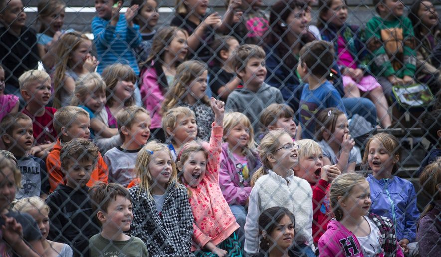 In this Thursday, May 19, 2016 photo, Priest River Elementary students cheer during the launching of a rocket during the 25th anniversary celebration of 5th grade teacher Chris Naccarato's NASA Aerospace Program in Priest River, Idaho. (Kathy Plonka/The Spokesman-Review via AP) MANDATORY CREDIT