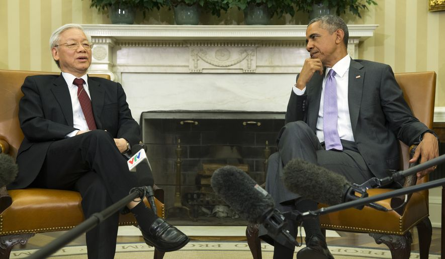 In this photo taken July 7, 2015, President Barack Obama meets with Vietnamese Communist party secretary general Nguyen Phu Trong in the Oval Office of the White House in Washington.  Mr. Obama is off on a weeklong, 16,000-mile trip to Asia as part of his effort to pay more attention to the region and boost economic and security cooperation.  (AP Photo/Evan Vucci) **FILE**