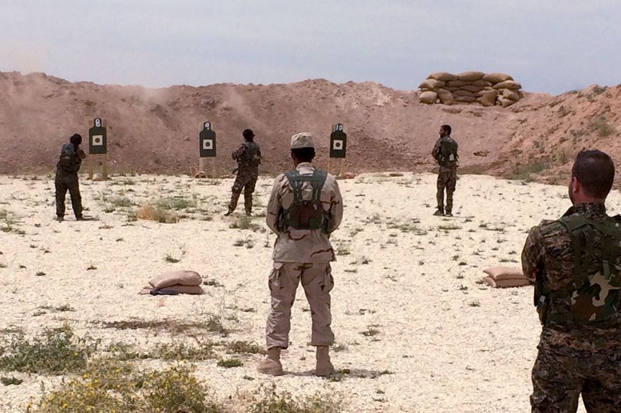 Syrian Arab trainees practice firing their small arms at an undisclosed training range in northern Syria on Saturday, May 21, 2016.  Army Gen. Joseph Votel, the top U.S. commander for the Middle East has secretly visited Syria for a first-hand look at efforts to build cohesive alliances of Arab, Kurd and other local fighters to defeat the Islamic State.  (AP Photo/Robert Burns)