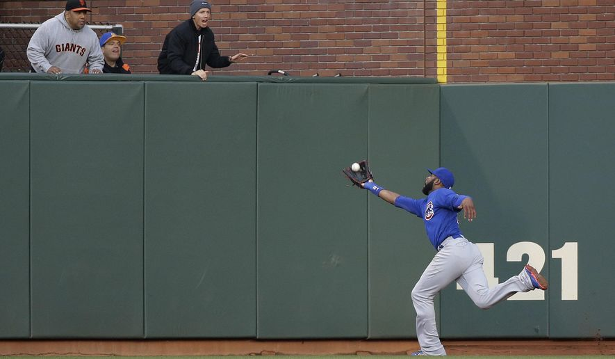 Chicago Cubs right fielder Jason Heyward catches a fly ball hit by San Francisco Giants' Denard Span during the first inning of a baseball game Friday, May 20, 2016, in San Francisco. Heyward was injured on the play and left the game. (AP Photo/Eric Risberg)