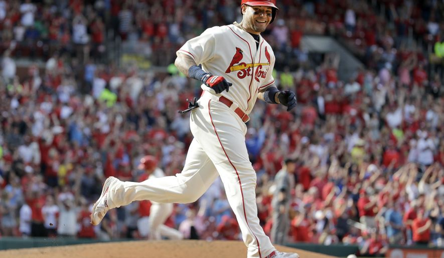 St. Louis Cardinals' Yadier Molina smiles as he rounds the bases after hitting a two-run home run during the seventh inning of a baseball game against the Arizona Diamondbacks Saturday, May 21, 2016, in St. Louis. (AP Photo/Jeff Roberson)