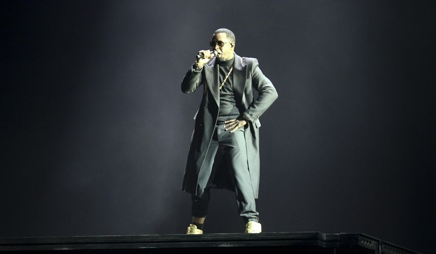Sean Combs performs during the Bad Boy Family Reunion Show at the Barclay's Center on Friday, May 20, 2016, in New York. (Photo by Andy Kropa/Invision/AP)