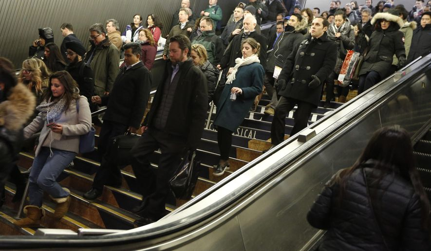 FILE--In this Jan. 6, 2016 file photo, commuters stream into Pennsylvania Station during the afternoon rush in New York. Gov. Andrew Cuomo hopes a new agency will help smooth the way for massive state construction projects like the planned $29 billion mass transit overhaul in New York City, but critics worry about a power grab by the Democratic leader. (AP Photo/Kathy Willens, File)
