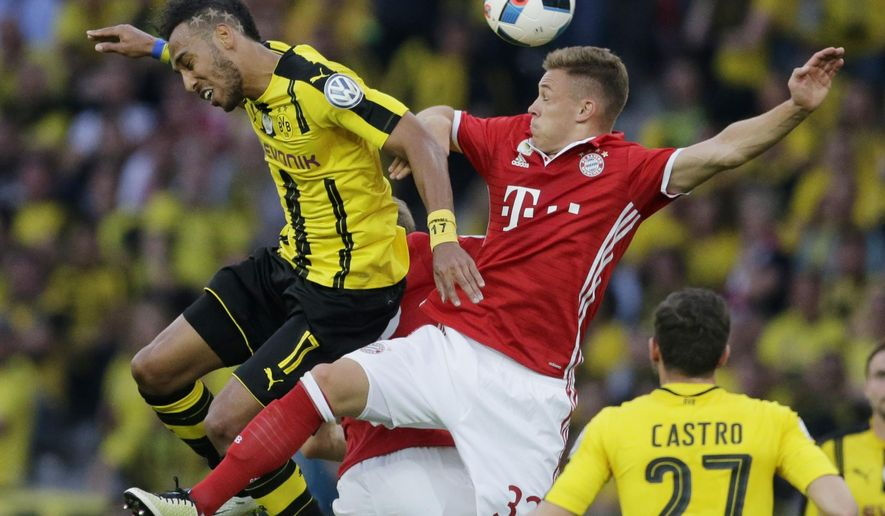 CORRECTS DATE - Dortmund's Pierre-Emerick Aubameyang, left, and Bayern's Joshua Kimmich challenge for the ball during the German soccer cup final match between Borussia Dortmund and FC Bayern Munich in Berlin, Germany, Saturday, May 21, 2016. (AP Photo/Markus Schreiber)