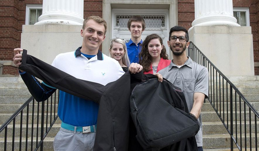 From left, Joe Hutchins, communications director; Alex Smith, media and communications; Scott Johnson, design specialist; Bonnie Monnier, video editor; and Haroon Pasha, program manager, members of the Hood College student club holding up the Backet, a combination backpack and winter jacket for homeless people on May 10, 2016 in Frederick, Md.  In March, the Hood team was named a regional champion and a rookie of the year in a regional competition by Enactus, a social entrepreneurship organization in Washington.  (Bill Green/The Frederick News-Post via AP) MANDATORY CREDIT