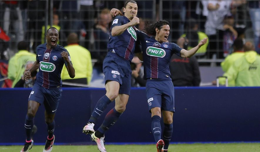 PSG's Zlatan Ibrahimovic, center, reacts, with PSG's Edinson Cavani, right, after scoring his side second goal during the French Cup final soccer match between Marseille and PSG at the Stade de France Stadium, in Saint Denis, North of Paris, Saturday, May 21, 2016. (AP Photo/Francois Mori)
