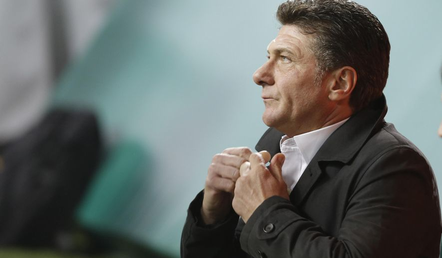 FILE - A Sunday, Nov. 9 , 2014 photo from files showing Inter Milan coach Walter Mazzarri waiting for the start of a Serie A soccer match between Inter Milan and Hellas verona, at the San Siro stadium in Milan, Italy. English Premier League team Watford has appointed Walter Mazzarri as its new head coach on a three-year contract, starting July 1. (AP Photo/Luca Bruno, File)