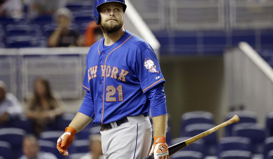 FILE - In this Sept. 2, 2014, file photo, New York Mets' Lucas Duda walks to the dugout after striking out during a baseball game against the Miami Marlins in Miami. Duda is out of the lineup again on Saturday, May 21, 2016, with a bad back, and the Mets certainly sound concerned about their power-hitting first baseman.  (AP Photo/Lynne Sladky, File)