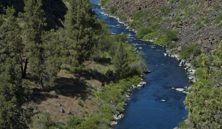 ADVANCE FOR WEEKEND EDITIONS MAY 21-22 - In this Wednesday, May 11, 2016 photo, a section of the Middle Deschutes River is visible near Crooked River Ranch, Ore. The salmonfly hatch on the Lower Deschutes is on, and anglers from throughout Oregon and even across the Northwest are flocking to Mecca Flat near Warm Springs for a chance at landing wild rainbow trout. (Ryan Brennecke/The Bulletin via AP) MANDATORY CREDIT