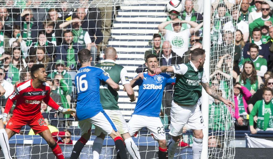 Hibernian's Anthony Stokes, right, scores his side's second goal of the game during the Scottish Cup Final soccer match between Rangers and Hibernian, at Hampden Park, Glasgow, Scotland. Saturday May 21, 2016. (Jeff Holmes /PA via AP) UNITED KINGDOM OUT - NO SALES - NO ARCHIVES
