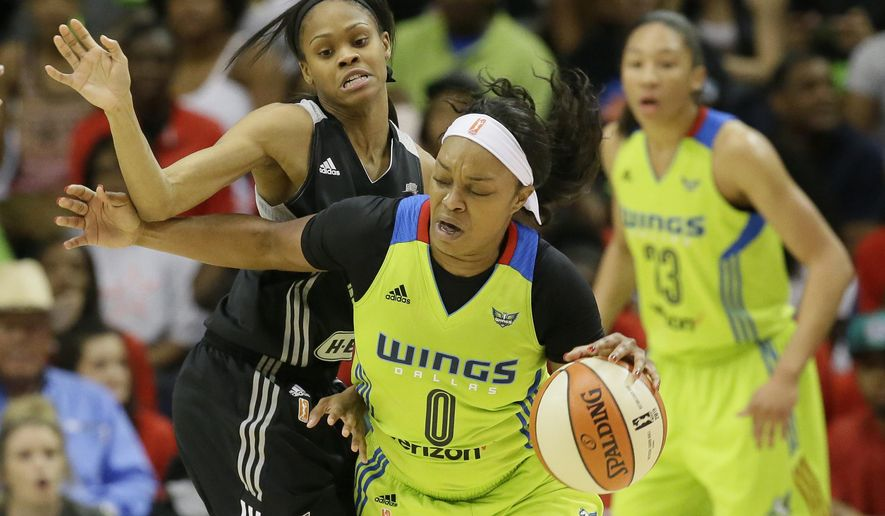 Dallas Wings guard Odyssey Sims (0) drives against San Antonio Stars guard Moriah Jefferson during the first half of a WNBA basketball game in Arlington, Texas, Saturday, May 21, 2016. (AP Photo/LM Otero)