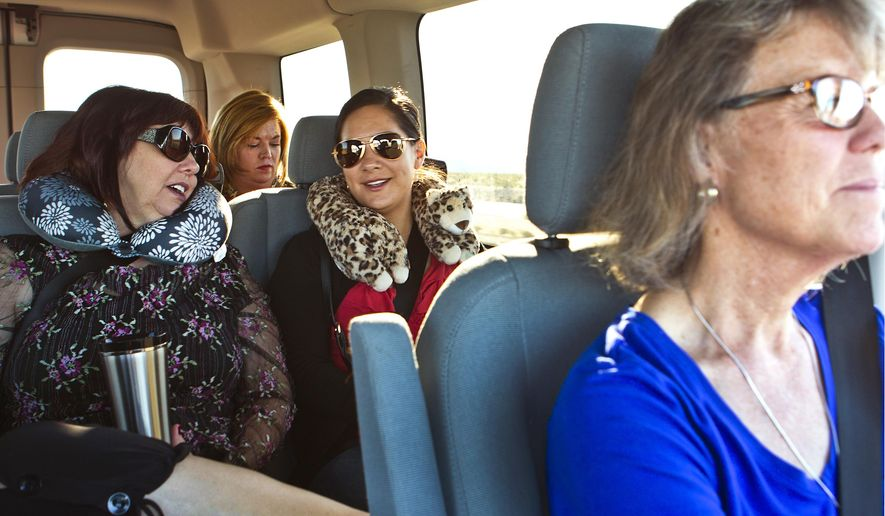In this May 3, 2016 photo, a group of Las Vegas teachers depart every morning at 6 a.m. in a large van and drive to Baker, Calif. to work at the school. (L.E. Baskow/Las Vegas Sun via AP) LAS VEGAS REVIEW-JOURNAL OUT; MANDATORY CREDIT
