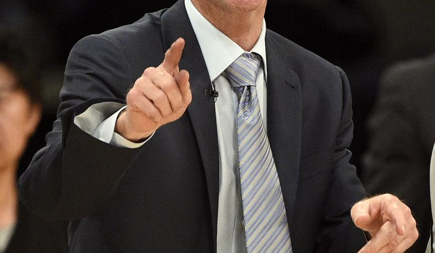 FILE - In this March 6, 2016, file photo, Golden State Warriors head coach Steve Kerr yells to the officials to question a call during the second half of an NBA basketball game against the Los Angeles Lakers in Los Angeles. Billy Donovan is trying to lead the Oklahoma City Thunder to a championship as a first-year NBA coach, just as Kerr did with Golden State last year. Friends off the court, their teams are 1-1 in the Western Conference finals that resume Sunday night at Oklahoma City.  (AP Photo/Kelvin Kuo, File)
