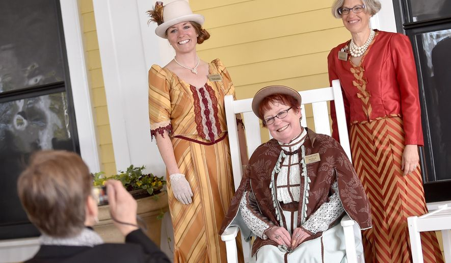 ADVANCE FOR THE WEEKEND OF MAY 21-22 AND THEREAFTER - In a May 13, 2016 photo, Yellowstone employees, from left, Crystal Cassidy, Michelle Trappen and Darla Kolk-Choquette wear period dresses during the 125th anniversary celebration of Lake Yellowstone Hotel. (Hannah Potes/The Billings Gazette via AP) MANDATORY CREDIT