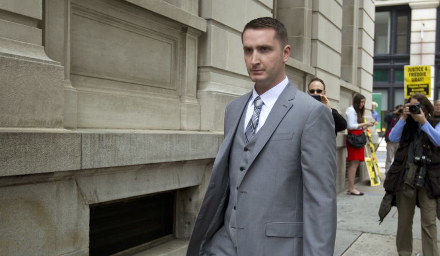 This May 12, 2016, file photo shows officer Edward Nero, one of six Baltimore city police officers charged in connection to the death of Freddie Gray, arriving at a courthouse at the beginning of his trial in Baltimore Md. A judge is expected Monday, May 23, 2016, to hand down his verdict in the case of the Baltimore police officer charged in the arrest and subsequent death of Freddie Gray. (AP Photo/Jose Luis Magana, file)