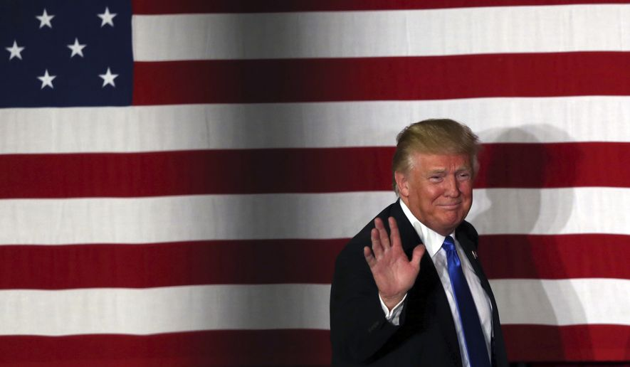 Republican presidential candidate Donald Trump waves during a campaign event in Lawrenceville, N.J., on May 19, 2016. (Associated Press) **FILE**