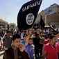 Demonstrators chant pro-Islamic State group slogans as they wave the group's flags in front of the provincial government headquarters in Mosul, Iraq, on June 16, 2014. (Associated Press) ** FILE **