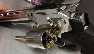 This photo posted to Twitter on May 8, 2016, by the Arlington Police Department shows a BB gun and fake ammunition that were taken from a drug suspect police say. Police in Texas say more crimes are being committed with imitation weapons like BB guns, likely because they're cheap, easy to obtain and criminals may mistakenly believe that if they're caught, they'll avoid the severe punishment that can come with a serious weapons charge. (Arlington Police Department via AP)