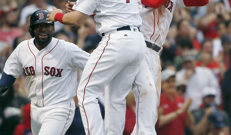 Boston Red Sox's Mookie Betts, right, celebrates his grand slam that also drove in Christian Vazquez (7) and Jackie Bradley Jr., left, during the seventh inning of a baseball game against the Cleveland Indians in Boston, Saturday, May 21, 2016. (AP Photo/Michael Dwyer)