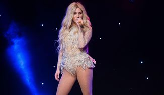 FILE - In this April 16, 2015 file photo, Kesha performs at the 2015 Delete Blood Cancer Gala in New York. Kesha will perform at the Billboard Music Awards on Sunday, May 22, 2016, airing on ABC. (Photo by Charles Sykes/Invision/AP, File)