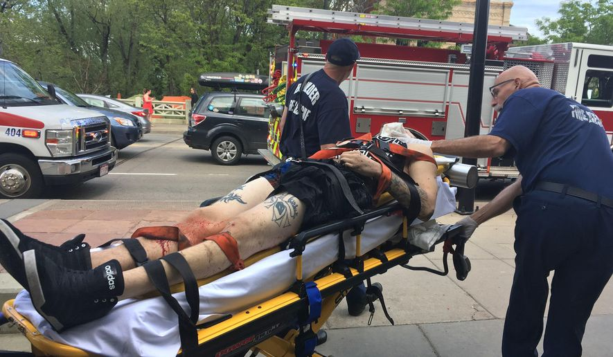 Paramedics wheel away a wounded suspect at the scene where the man was shot by police, under a bridge in downtown Boulder, Colo., Sunday, May 22, 2016. According to the Boulder Police Department, police responded after the man discharged a gun into Boulder Creek, and then after the man pointed his gun at an officer, police shot the man. (AP Photo/Brennan Linsley)
