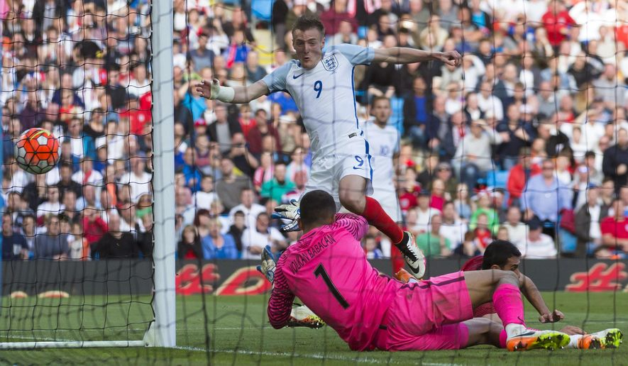England's Jamie Vardy, top, scores past Turkey's goalkeeper Volkan Babakan during their international friendly soccer match at the City of Manchester Stadium, Manchester, England, Sunday May 22, 2016. (AP Photo/Jon Super)