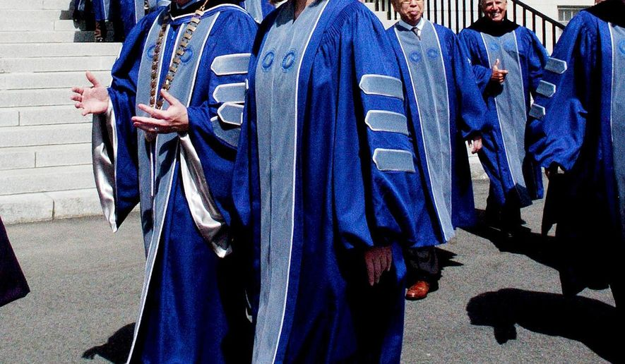 Arianna Huffington, author and editor-in-chief of the Huffington Post, walks with Colby College President David Greene during the commencement procession at the Waterville, Maine campus on Sunday, May 22, 2016. Huffington was the commencement speaker and received an honorary degree. (David Leaming/The Central Maine Morning Sentinel via AP) MANDATORY CREDIT