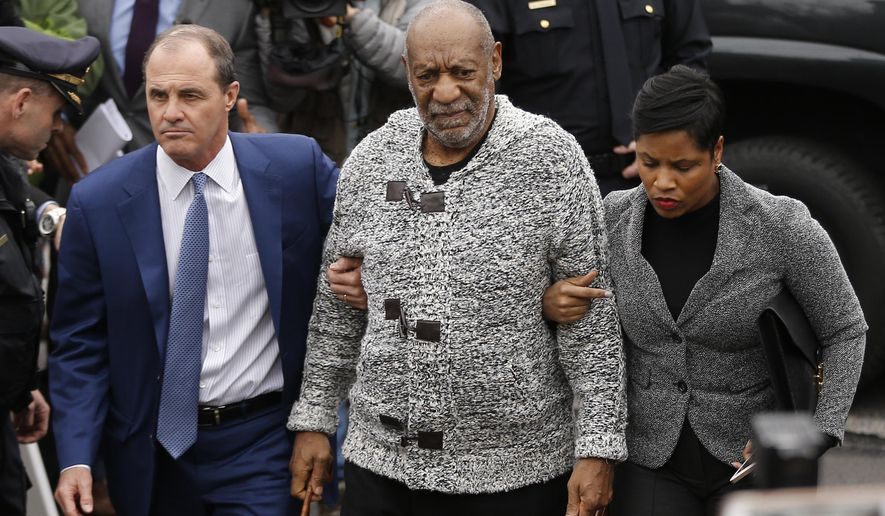 FILE - In this Dec. 30, 2015, file photo, Bill Cosby, center, accompanied by his attorneys Brian McMonagle, left, and Monique Pressley, arrives at court to face a felony charge of aggravated indecent assault in Elkins Park, Pa. Cosby faces a preliminary hearing Tuesday, May 24, 2016, to determine if his criminal sex-assault case in suburban Philadelphia goes to trial. (AP Photo/Matt Rourke, File)