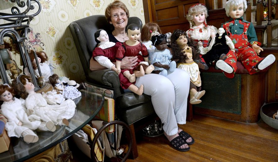 ADVANCE FOR THE WEEEKEND OF MAY 21-22 AND THEREAFTER - Martha Clyde, of Burlington, has collected over 100 dolls and been collecting them for over 36 years. Clyde collects dolls and works on them as a hobby.  She also makes some of the clothes. Clyde has dolls from modern, antiques, handmade, and many more. (Jeff Brown/The Hawk Eye via AP)