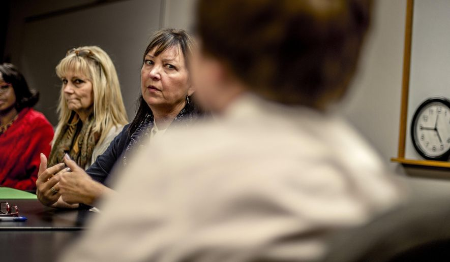 ADVANCE FOR THE WEEKEND OF MAY 21-22 AND THEREAFTER - In a Nov. 18, 2015 photo, the Truancy Board of the Puyallup School District interview a student and his mother during a hearing at the school district's office in Puyallup, Wash. Starting in fall of 2017, school districts will be required to offer community truancy boards, an intervention that state lawmakers have long recommended to keep truant students out of court and juvenile detention. (David Montesino/The News Tribune via AP)