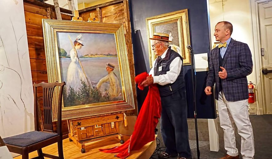 A Saturday, May 21, 2016 photo provided by the Portsmouth Historical Society shows a newly discovered and restored Edmund C. Tarbell painting being unveiled by Edmund C. Tarbell II, center, grandson of the painter, and Jeremy Fogg, guest curator and conservator, at the Discover Portsmouth visitors' center in Portsmouth, NH. The painting that was rolled up and forgotten for more than a century has been restored just in time to be included in a large retrospective of the artist's work. (Bill Moore/Portsmouth Historical Society via AP)