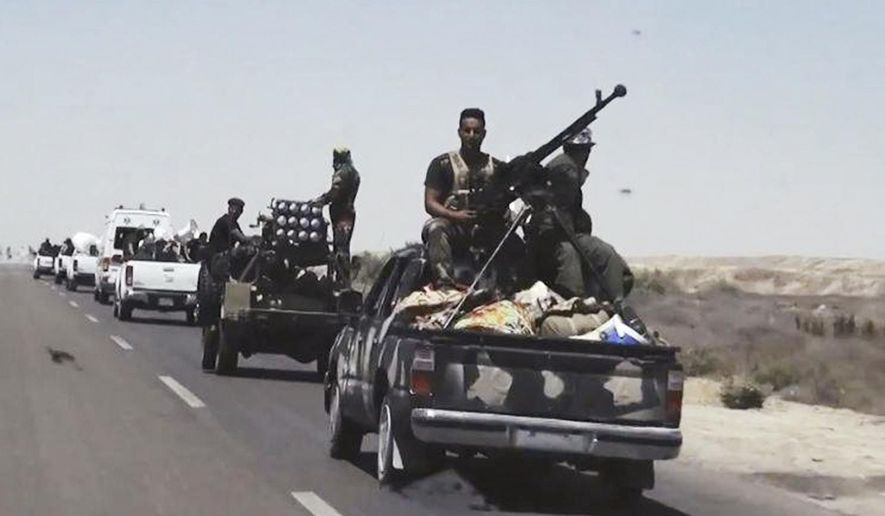 "File- This July 13, 2015, file photo shows Iraqi security forces backed by Shiite and Sunni pro-government fighters preparing to attack Islamic State group positions in Fallujah, 40 miles (65 kilometers) west of Baghdad, Iraq.  Iraqi Prime Minister Haider al-Abadi announced the beginning of military operations to retake the Islamic State-held held city of Fallujah, west of Baghdad in a televised address Sunday, May 22, 2016. Iraqi forces are ""approaching a moment of great victory"" against the Islamic State group, al-Abadi said surrounded by top military commanders from the ministry of defense and the country's elite counter terrorism forces. Fallujah has been under the control of IS for more than two years. (AP Photo, File)"