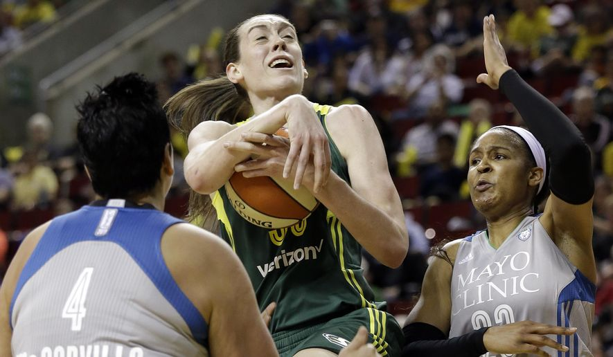 Seattle Storm's Breanna Stewart, center, tries to drive between Minnesota Lynx's Janel McCarville (4) and Maya Moore in the first half of a WNBA basketball game Sunday, May 22, 2016, in Seattle. (AP Photo/Elaine Thompson)