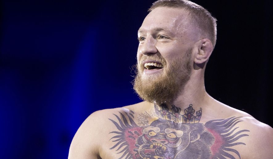 "FILE - In this Wednesday, March 2, 2016 file photo, UFC featherweight champion Conor McGregor smiles during open workouts for UFC 196 at MGM Grand in Las Vegas. McGregor says his dispute with UFC became a ""publicized civil war"" once he refused to participate in promotion for a fight against Nate Diaz, and the wildly-popular fighter took his unhappiness to social media. McGregor said he remained ""committed to the fight game"" and met with UFC officials recently in California to smooth out the relationship. (Steve Marcus/Las Vegas Sun via AP) LAS VEGAS REVIEW-JOURNAL OUT; MANDATORY CREDIT"